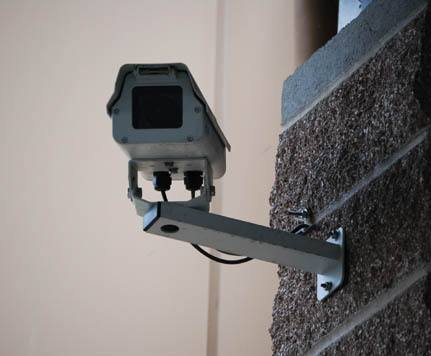 Security camera mounted outside to brick wall